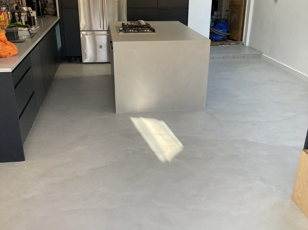 Mid grey microcement kitchen floor and island