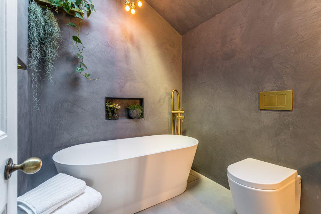 dark grey Tadelakt bathroom with mid grey microcement floor
